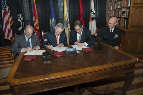 PRINCETON, N.J. (April 15, 2014) Secretary of the Navy (SECNAV) Ray Mabus, second from left, President of Rutgers University Robert Barchi, left, and President of Princeton University Christopher Eisgruber sign an agreement bringing Navy ROTC back to Princeton University, as Capt. Philip Roos, commanding officer of Rutgers Navy ROTC looks on. (U.S. Navy photo by Mass Communication Specialist 1st Class Arif Patani/Released)